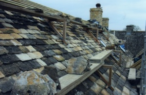 Cost effective roofing repairs Swindon company - reusing old Cotswold stone roof tiles and mixing with new stone tiles, roof repairs company near Cirencester